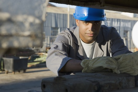 african descent ethnicity: African American male construction worker wearing hardhat