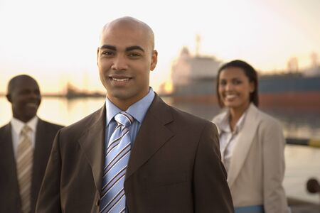freighter: African American businesspeople in front of freighter LANG_EVOIMAGES