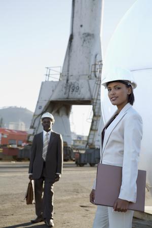 garment industry: African American businesspeople wearing hardhats