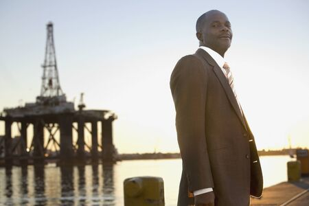 joining forces: African American businessman on commercial pier