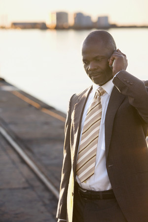joining forces: African American businessman talking on cell phone
