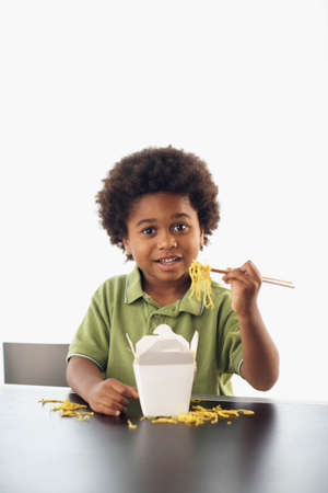 rockclimber: African American boy eating takeout noodles