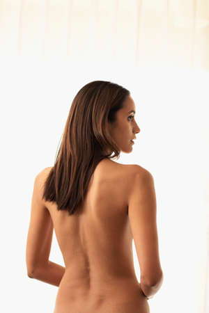 1 woman only: Rear view of nude Hispanic woman LANG_EVOIMAGES