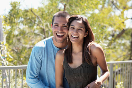 cardboard only: Multi-ethnic couple laughing outdoors