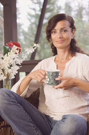 french ethnicity: Mature woman holding coffee mug LANG_EVOIMAGES