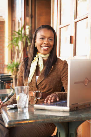 typist: African American businesswoman at cafe