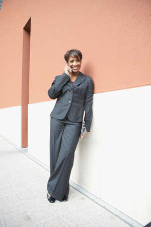 joining forces: African American businesswoman talking on cell phone