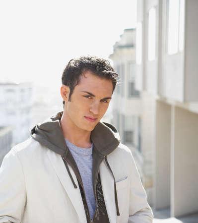 hooded sweatshirt: Young man wearing hooded sweatshirt LANG_EVOIMAGES