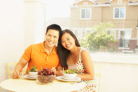 Asian couple at breakfast table
