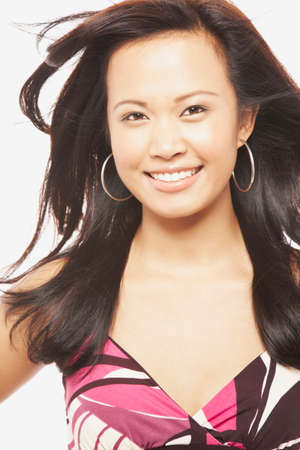 pacific islander ethnicity: Asian woman with hair blowing