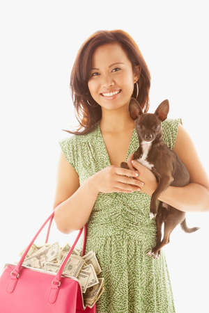dollarbill: Asian woman holding handbag full of money and dog