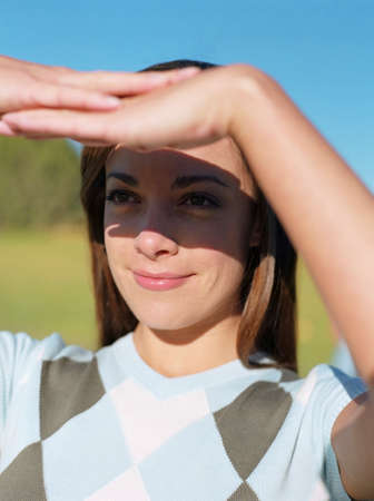 wearying: Woman shading eyes with hands
