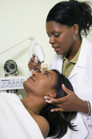 African woman receiving spa facial treatment Stock Photo