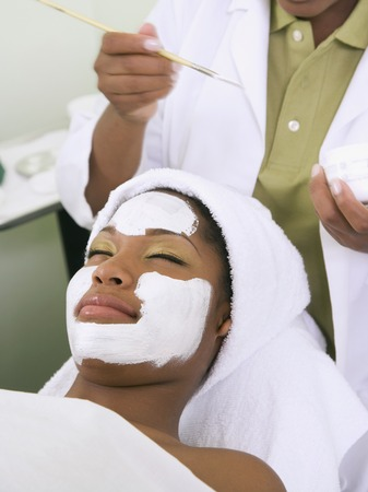 ostentatious: African woman receiving spa facial treatment LANG_EVOIMAGES