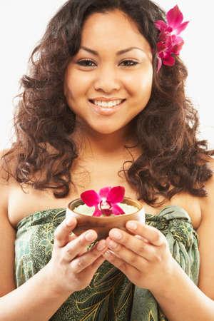 pacific islander: Pacific Islander woman holding bath salts LANG_EVOIMAGES