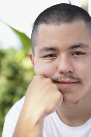 islander: Pacific Islander man resting chin on hand
