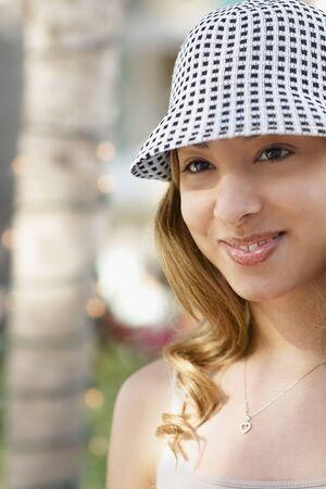 gratifying: Hispanic woman wearing hat