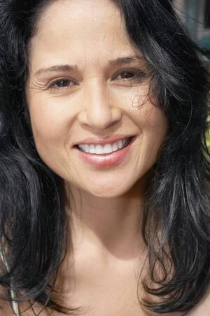 lust: Close up of Hispanic woman smiling