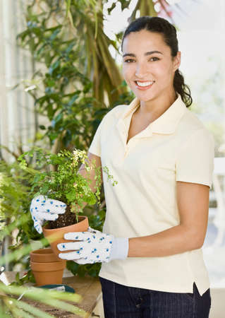 woman gardening: Hispanic woman gardening