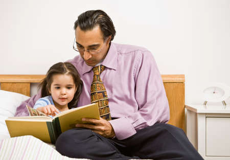 30 34 years: Father and daughter reading