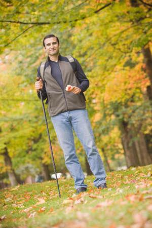 walking pole: Hispanic man holding walking pole