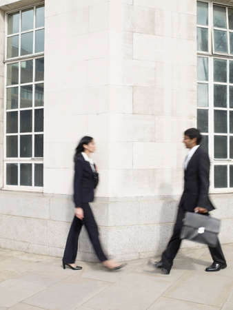 being the case: Multi-ethnic businesspeople walking around corner LANG_EVOIMAGES