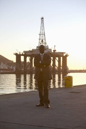 African American businessman on commercial pier