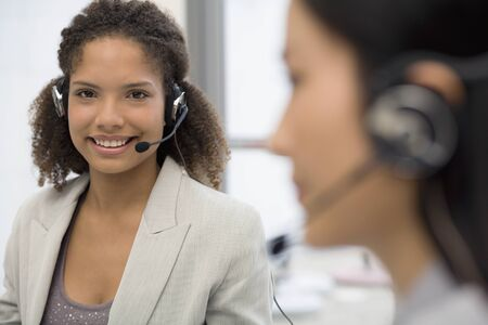 African businesswoman wearing headset Stock Photo