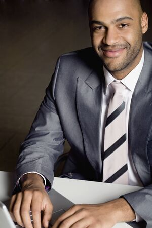daydreamer: African businessman typing on laptop