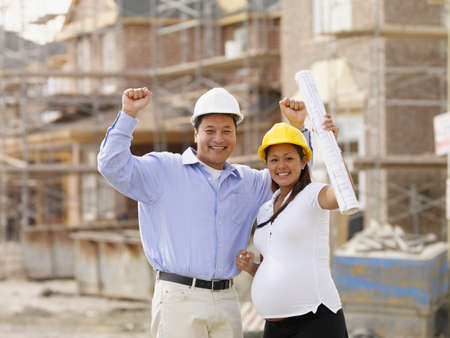 architect drawing: Pregnant Asian couple cheering at construction site