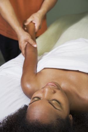 bathtowel: African woman receiving massage LANG_EVOIMAGES