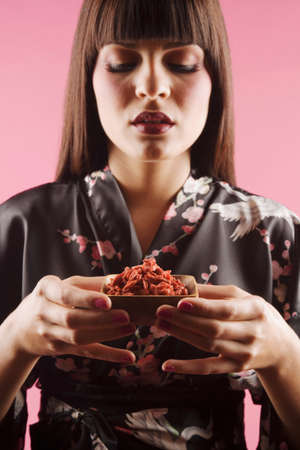 middle eastern: Middle Eastern woman holding gogi berries