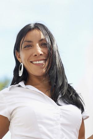 impassive: Low angle view of Hispanic woman