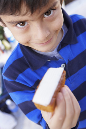 devilment: Hispanic boy holding bread and cheese LANG_EVOIMAGES