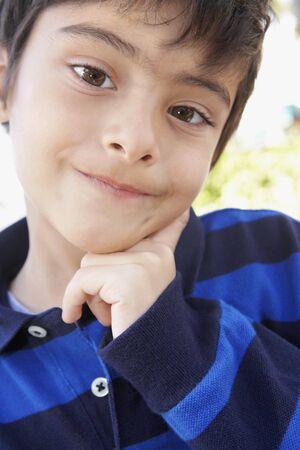 skepticism: Hispanic boy making a face