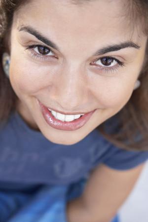 motioning: Close up of Hispanic woman smiling