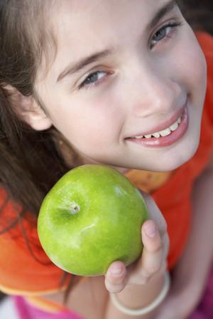 typist: Hispanic girl holding apple