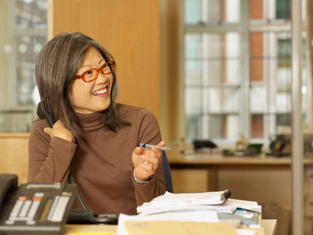 mid life: Asian businesswoman looking to side