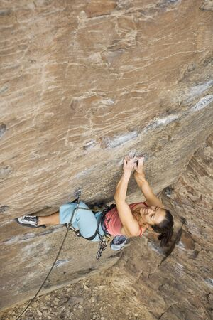 rockclimber: Asian woman rock climbing LANG_EVOIMAGES