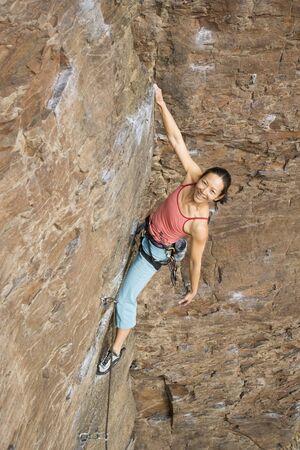 rockclimbing: Asian woman rock climbing LANG_EVOIMAGES