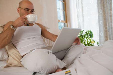 squatter: Hispanic man looking at laptop LANG_EVOIMAGES