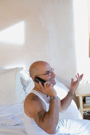 interrogating: Hispanic man talking on telephone