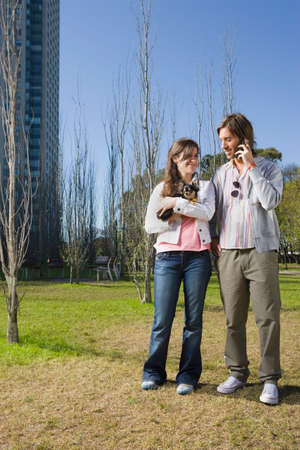 talker: Couple with small dog in park
