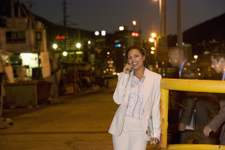 fulfilling: African American businesswoman talking on cell phone