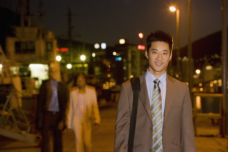 nite: Asian businessman outdoors at night LANG_EVOIMAGES