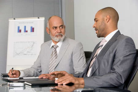 two person only: African businessmen having meeting