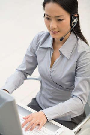 handsfree: Asian businesswoman wearing headset