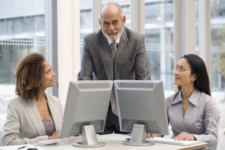 honeymooner: Multi-ethnic businesspeople behind computers