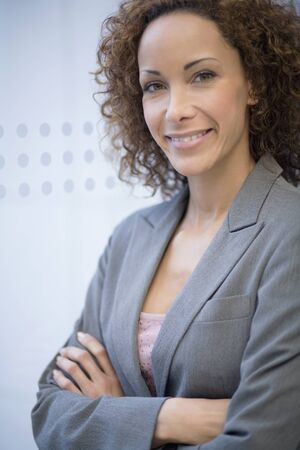 african american woman business: African businesswoman with arms crossed LANG_EVOIMAGES