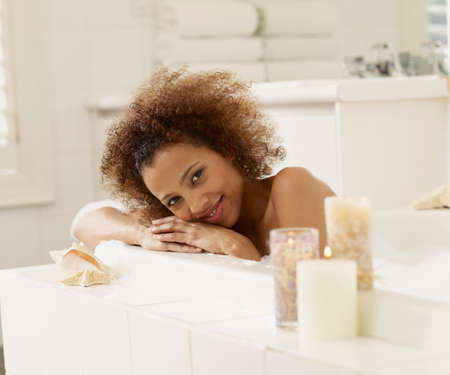 woman in bath: African woman in bubble bath